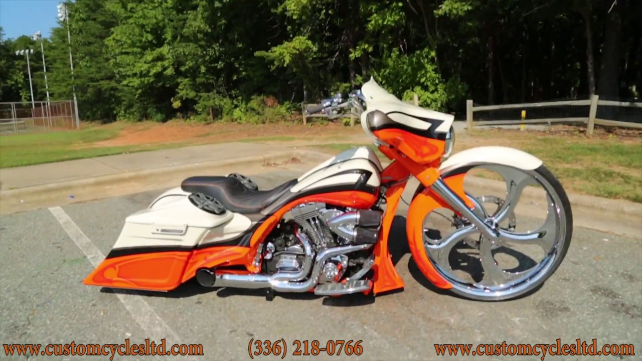 Huge orange harley davidson with black wheels girls young naked