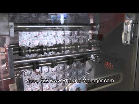 Machine for group packing of tablets in aluminium foil strip. Video 322 www.Pharma-Manager.com