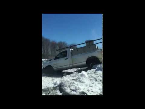 Dude sends it off snow bank in pickup