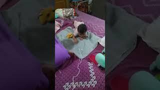 Malu baby trying to get earplugs