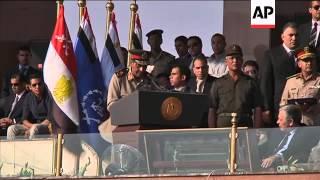 New Egypt President Morsi attends military parade