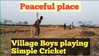 Village Boys playing Simple Cricket with Clean air