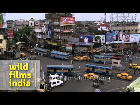 Kolkata traffic : establishing shot with Howrah bridge in backdrop