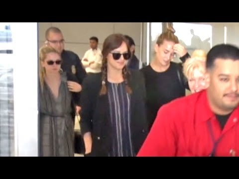 Dakota Johnson And Sisters Stella And Grace Arrive At LAX After Attending Gucci Cruise In Italy