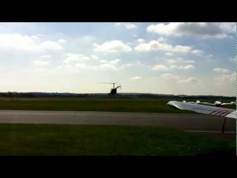 Robinson R22 helicopter student learning to fly returning to Cambridge Airport