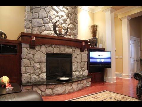 tv beside fireplace
