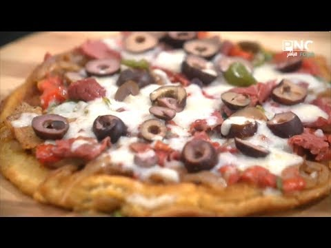 صورة  طريقة عمل البيتزا البلدي يوكل مع الشيف نونا | طريقة عمل البيتزا السائلة - أسهل أنواع البيتزا طريقة عمل البيتزا من يوتيوب
