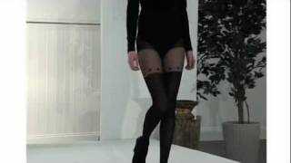 Sexy Model Wears Saucy Suspender Tights