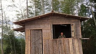 Bushcraft young man build beautiful bamboo house