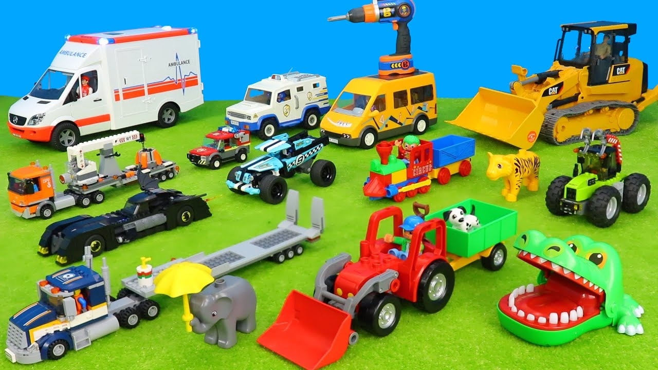 kinderspielzeugautoskrankenwagenlasterkrantraktoren