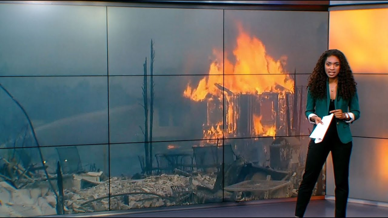 Thousands flee deadly California wildfires