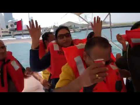 Guest Enjoying Yacht Ride in Diwali Dubai Tour | Heena Tours.