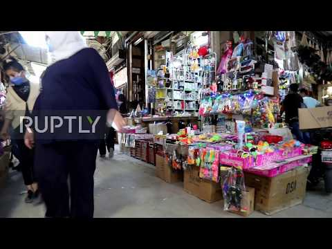 Syria: Shoppers pack public markets in Damascus as lockdown eases
