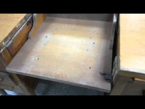 Antique desk with typewriter compartment