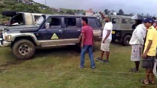 Nissan Patrol Safari 4x4 offroad pulls landcruiser from mud hole in Sri Lanka.mp4