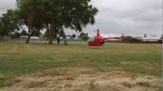 Robinson R22 landing at Cloverlea School