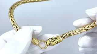 Vidéo: Collier tête de félin en or jaune 18 Cts maille palmier avec deux rubis.