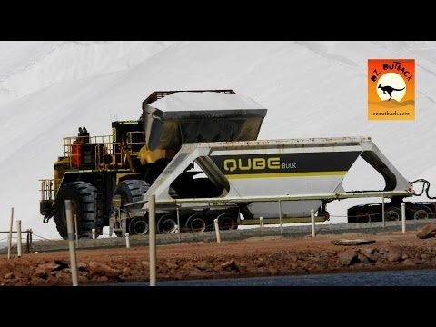 Front end loader loading road train for export at Port Hedland Salt mine - outback Western Australia