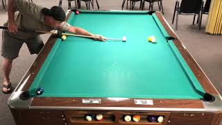 Guy Does Several One-Shot Pool Tricks - 1011511