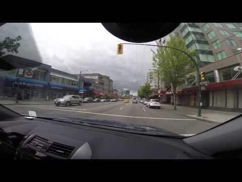 Driving on West Broadway in Vancouver, BC