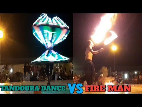 FANTASTIC PERFORMANCE FIRE MAN SHOW AND ARABIC TANDOURA DANCE IN DUBAI DESERT SAFARI CAMP