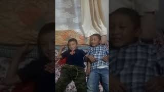 Two kids are singing o saathi song  very funny