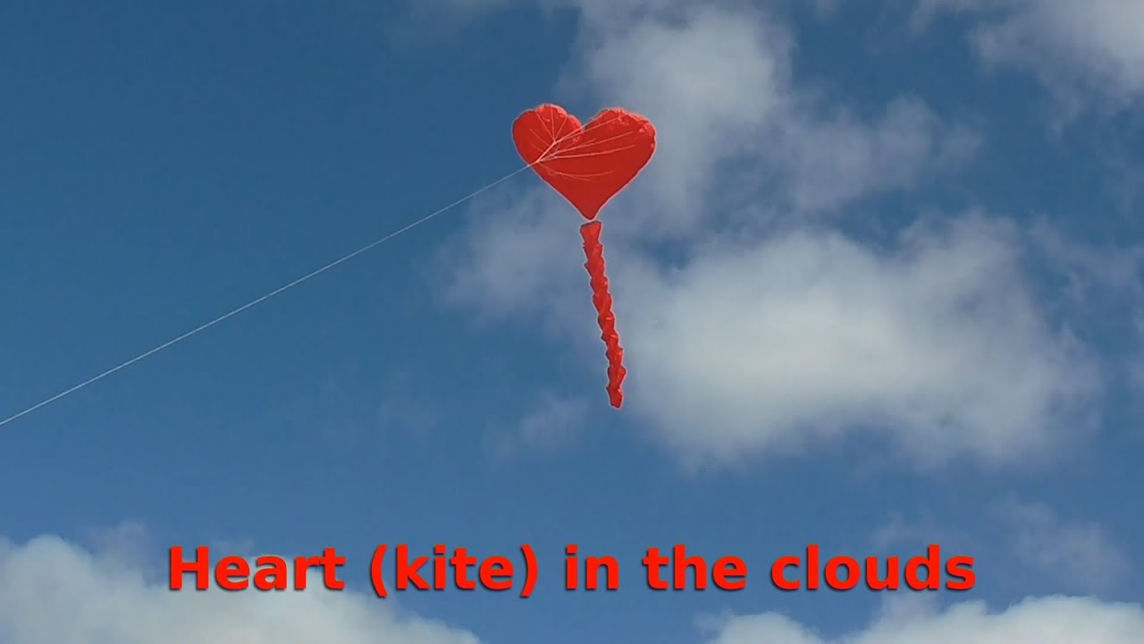 heart kite flies in the clouds - youtube
