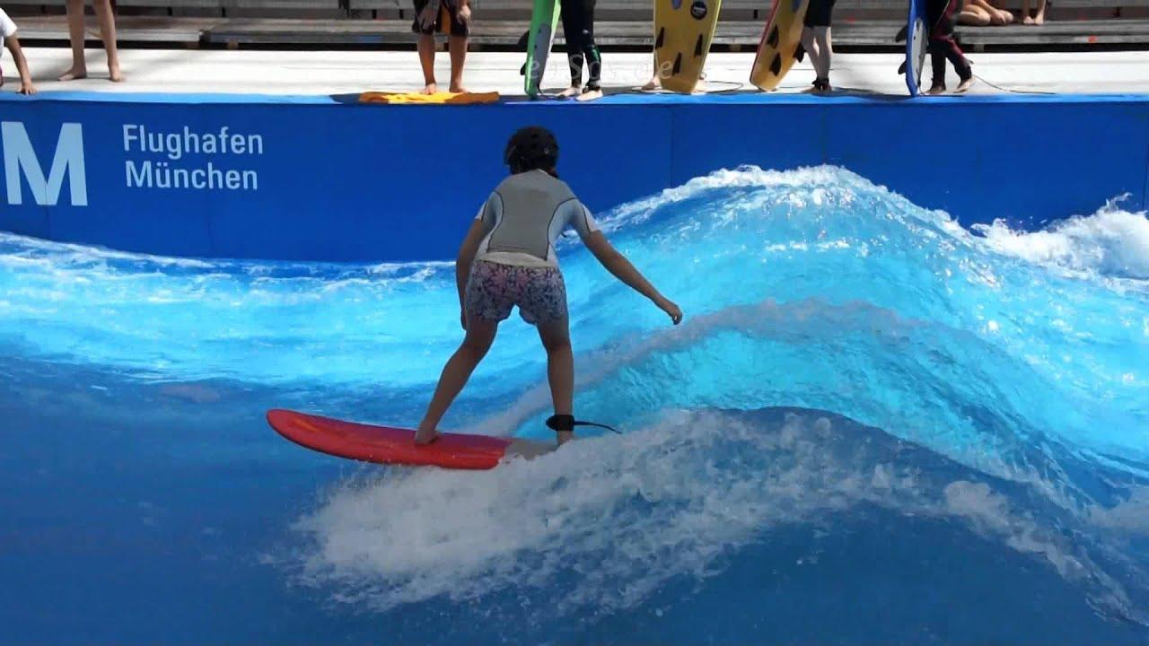 Children indoor Surfing in Wave Pool of Munich Airport