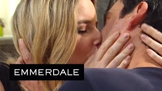 emmerdale cain and charity kiss in the woolpack
