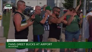 Fans welcome home the Milwaukee Bucks as they fly into Mitchell Airport