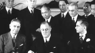 President Franklin D. Roosevelt signs Constitution of the Philippines