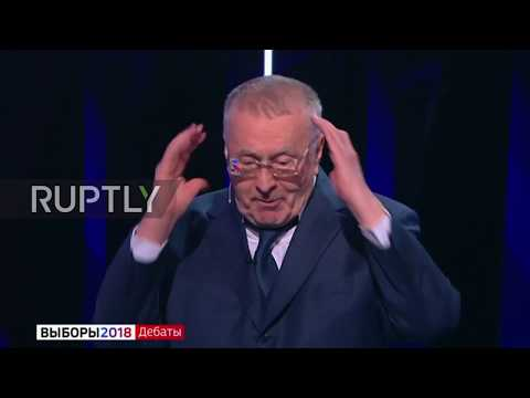 Russia: 'You Are A Whore' - Sobchak Douses Zhirinovsky With Water In Presidential Debate