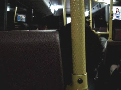 Bus passenger dozes off & risks his neck in the process