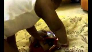 Baby Boy Desperately Gets Himself In a Toy Car