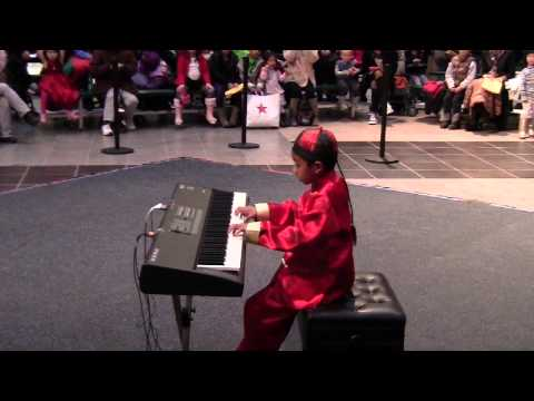 Eric Zhang Lawrence (age 7) Plays Songs In The 2014 Chinese Lunar New Year's Celebration