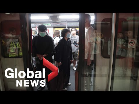 Hong Kong protesters try to block subway entrances to impact rush hour | LIVE