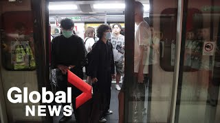 Hong Kong protesters try to block subway entrances to impact rush hour