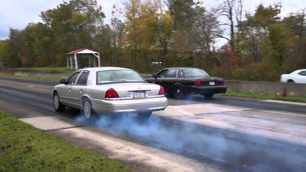 supercharged crown vic vs stock crown vic drag race - youtube