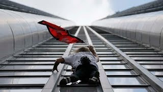 French 'Spiderman' Alain Robert climbs 689 ft Tower for Nepal Earthquake Victims