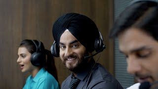Active young Indian executives wearing headsets while working - Call center support staff in night shift
