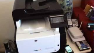 Installing ink into an Hp Colour Laserjet Pro CM1415FN printer