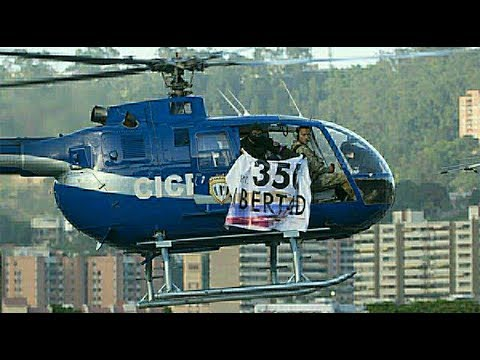 Venezuelan police use stolen helicopter in attack on gov't buildings