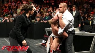A handcuffed Daniel Bryan is assaulted by Triple H and Stephanie McMahon: Raw, March 17, 2014