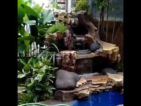 kolam dekorasi tebing konsep taman minimalis  tlp