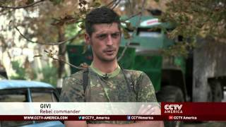 Small town near Donetsk feels wounds of battle
