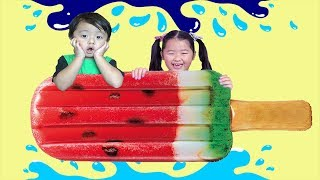 Kids Play with Big Inflatable Ice Cream Popsicle in Pool