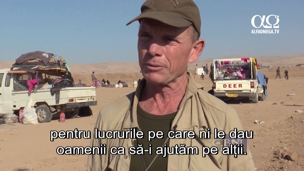Crestini care dau o mana de ajutor celor prinsi in schimbul de focuri din razboiul cu SIIL