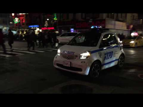 BABY MINI NYPD TRAFFIC SMART CAR PATROLLING ON WEST 47TH STREET IN MIDTOWN, MANHATTAN, NEW YORK.