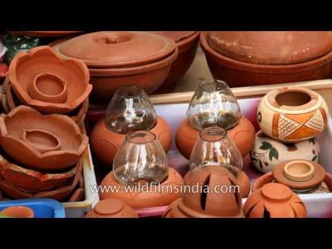 Decorative earthen lamps and statues for sale in local market of Chennai