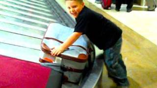 KID TACKLES SUITCASE!
